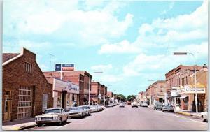 Le Sueur, Minnesota Postcard MAIN STREET Downtown Scene Ford Sign c1970s Unused