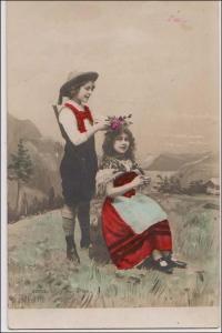 Boy Putting a Wreath on Girls Head