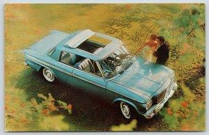 Studebaker~Lark Daytona Hardtop~Birdseye Over Sunroof~Postcard Advertisement