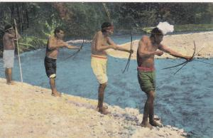 COSTA RICA , 00-10s : Talamanca Indians shooting fish with bow & arrow