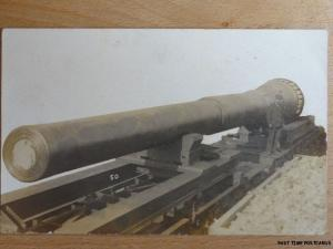 Antique RPPC - Large Cannon / Artillery Gun ? showing man standing at it's side.