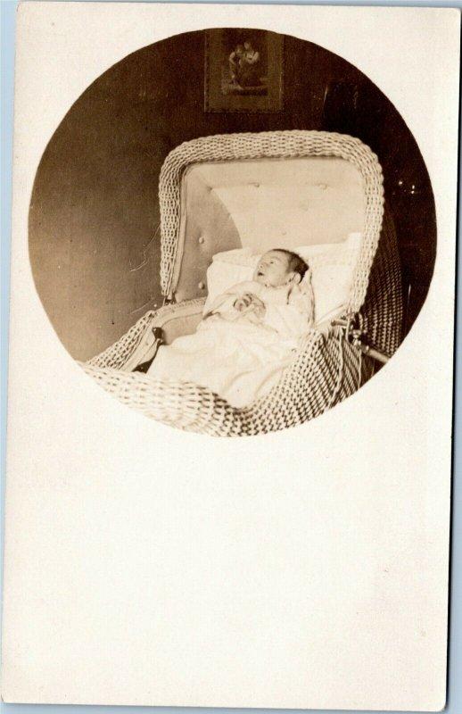 rppc Infant in wicker bassinet 1904-1918