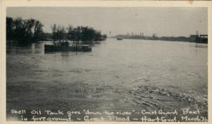 HARTFORD , Connecticut , 1936 ; Shell Oil Tank floating in Flood Waters