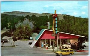 RAWLINS, WY  Roadside Lincoln Highway IDEAL MOTEL/ TRAVELODGE Tow Truck Postcard