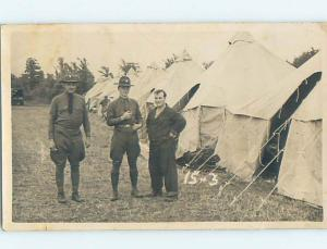 1940 rppc Military USA ARMY SOLDIERS BY TENTS Postmarked Canton NY HM2645