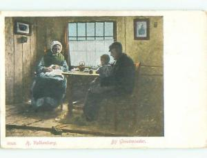 Unused Pre-1907 foreign signed CHILD WITH GRANDPARENTS AT TABLE J4241