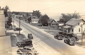 Houghton Lake Michigan~Street Scene~Houses~CLASSIC CARS~Lake Bknd~1940s RPPC