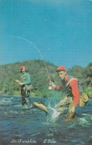 ST-PAMPHILE , Quebec , Canada , PU-1961 ; Man and Woman fishing