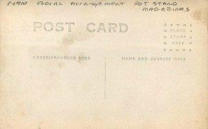 C-1910 Floral Arrangement Pot Stand Magazines RPPC Photo Postcard 20-11751
