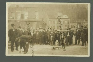 Marquette IOWA RP c1910 ROLLING A PEANUT Down Main Street BET WAGER nr McGregor
