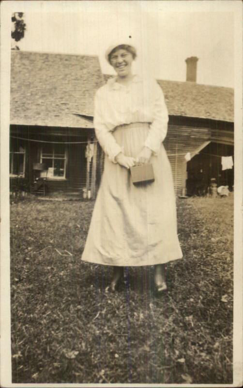 Woman in Skirt & Blouse Holding Camera c1910 Real Photo Postcard
