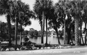 Florida~Palm Trees Along River~Dock~Houses in Background~1940s RPPC