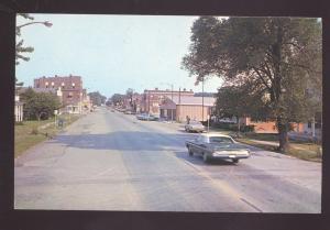 WELLSVILLE MISSOURI DOWNTOWN MAIN STREET SCENE 1960's CARS VINTAGE MO. POSTCARD