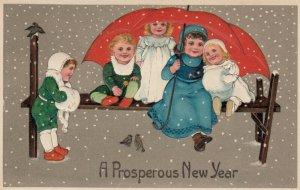 NEW YEAR, 1900-10s; Children sitting on bench under red umbrella,snow  PFB 8081