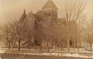 La Crosse Kansas~Rush County Court House~Snow on Ground~Lots of Trees~1910 RPPC