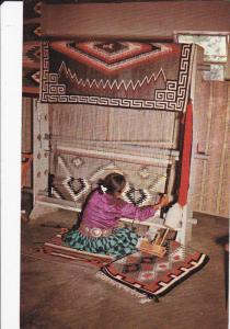 NEW MEXICO, 1940-1960's; Navajo Woman Weaving A Rug