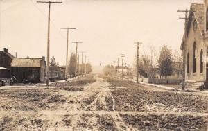 Lewistown Montana~Muddy Main Street~Tobacco~Church~Chicago Fur~1910 RPPC
