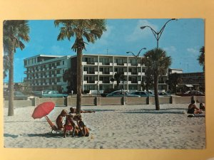 Beach view of 400 Motel with vintage cars on Clearwater Beach, Florida (FL-21)