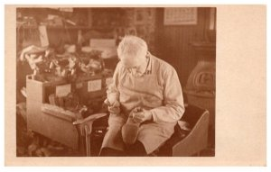 Shoemaker making shoes by hand