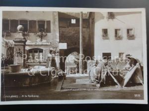 Old RPPC Switzerland: GRUYERES, A La Fontaine - showing women doing washing