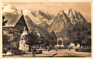 Garmisch Marktplatz Fountain Statue Hotel Vintage Cars Cyclist Postcard