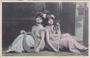 PU-1908; Girls Holding Musical Instruments