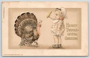 Jason Freixas Thanksgiving~Baby Girl Holds Up Corn Cob to Turkey~John Winsch