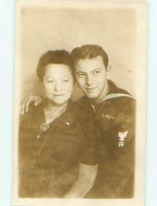 rppc Pre-1950 Military NAVY SAILOR HUGS WOMAN - PROBABLY HIS MOM AC8058