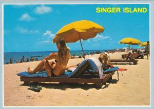 Sun Bathers At Singer Island Florida