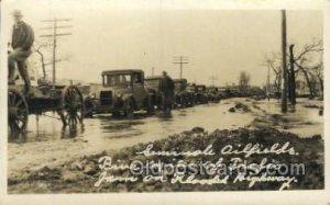 Oil Well, Oil fields, 5 miles of traffic on Flooded Highway, Unused light wea...