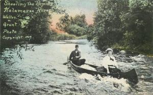 1909 Boat Couple Shooting Rapids Kalamazoo River Grant Michigan postcard 6107