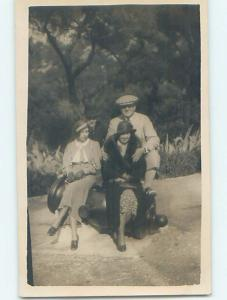 old rppc PEOPLE SITTING ON MILITARY CANNON country of Gibraltar HM1378