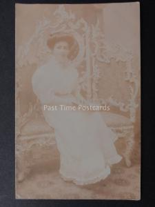 Studio Portrait of Smiling Young Lady with book on Grand Chair - Old RP Postcard