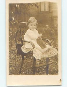 Pre-1918 rppc CHILD IN HIGH CHAIR HOLDING TEDDY BEAR HM3119