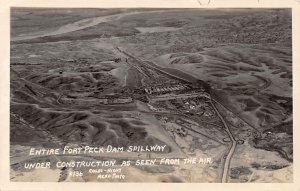 RPPC Fort Peck Spillway Under Construction Aerial View Montana Postcard ca 1930s