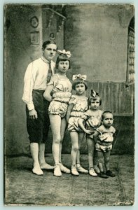 Circus Performers~5 Family Members~Trapeze or Tightrope~Children~c1910 Postcard