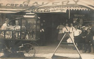 Bakery Coca-Cola Sign Popcorn Wagon Busy Storefront Real Photo Postcard