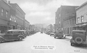 G19/ Newcomerstown Ohio Postcard c1940s Business District Stores Autos