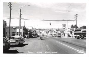 Omak WA~Main Street~Chevron Gas Station~Hamburg Heaven~Motorcycle~1950 Cars RPPC