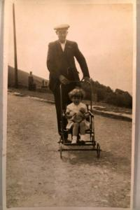 circa 1920 rppc LITTLE GIRL WITH TOY IN VERY OLD METAL STROLLER postcard y3971