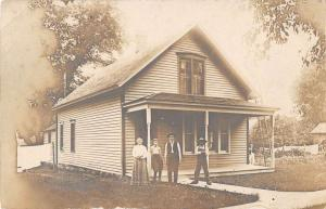Logan Iowa view of family outside their home real photo pc Y12043
