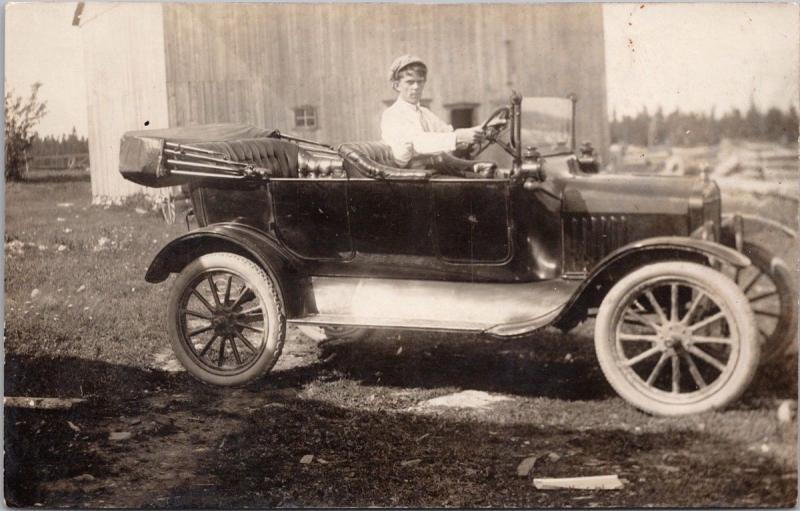 Man in Old Car Automobile Unknown Location RPPC Real Photo Postcard E35