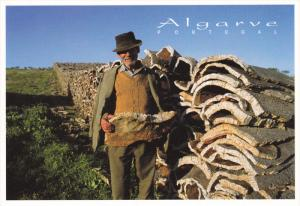 ALGARVE, Portugal, 1950-1970's; Man Collecting Cork Bark
