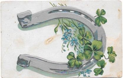 Nice embossed post card - a horseshoe and some four leaf clovers