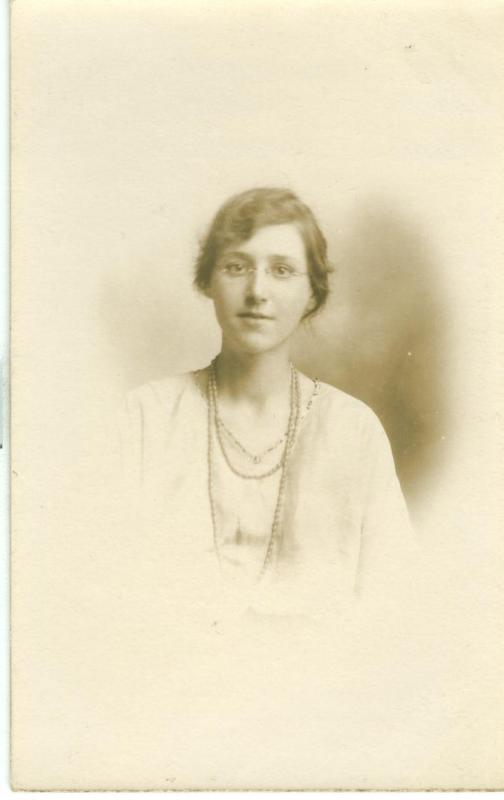 Woman, early 1900s used real photo UK Postcard