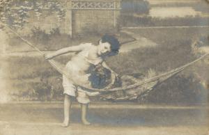 Boy with a dog on a hammock 01.70
