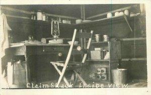 Claim Shack Inside View C-1910 Mining RPPC Photo Postcard 20-12502