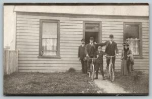 RPPC Boy Restrains Bikes Before Grown Men's Challenge~Lady w/Victorian Hat~c1910