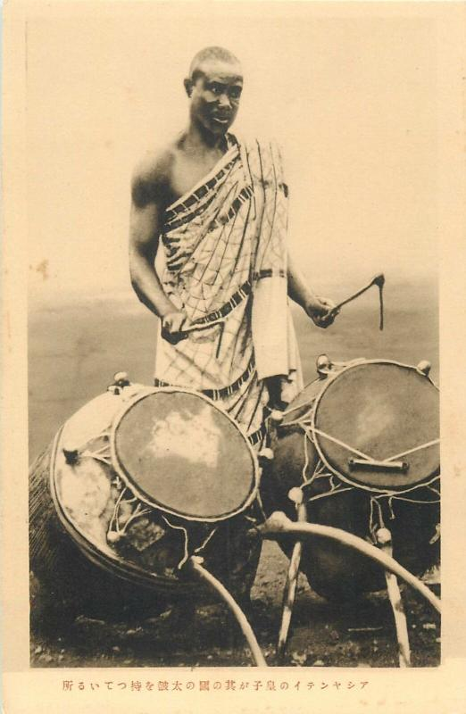 Ashanti Prince holding the drum made in that region Ghana Gold Coast West Africa