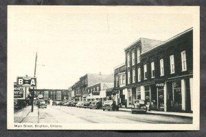 dc457 - BRIGHTON Ontario 1940s Main Street. Stores. Cars. B-A Service Sign